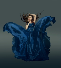 Woman in fluttering blue dress